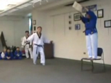 The classes Grand Master Taekwondo instructor shows the class how not to land a backflip kick.