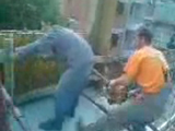 Frightened worker takes care of his balls
